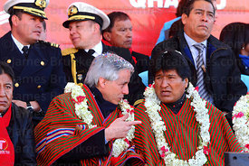 Bolivian president Evo Morales (right) and vice president Alvaro Garcia Linera (centre) during the cable car Red Line  inaugu...