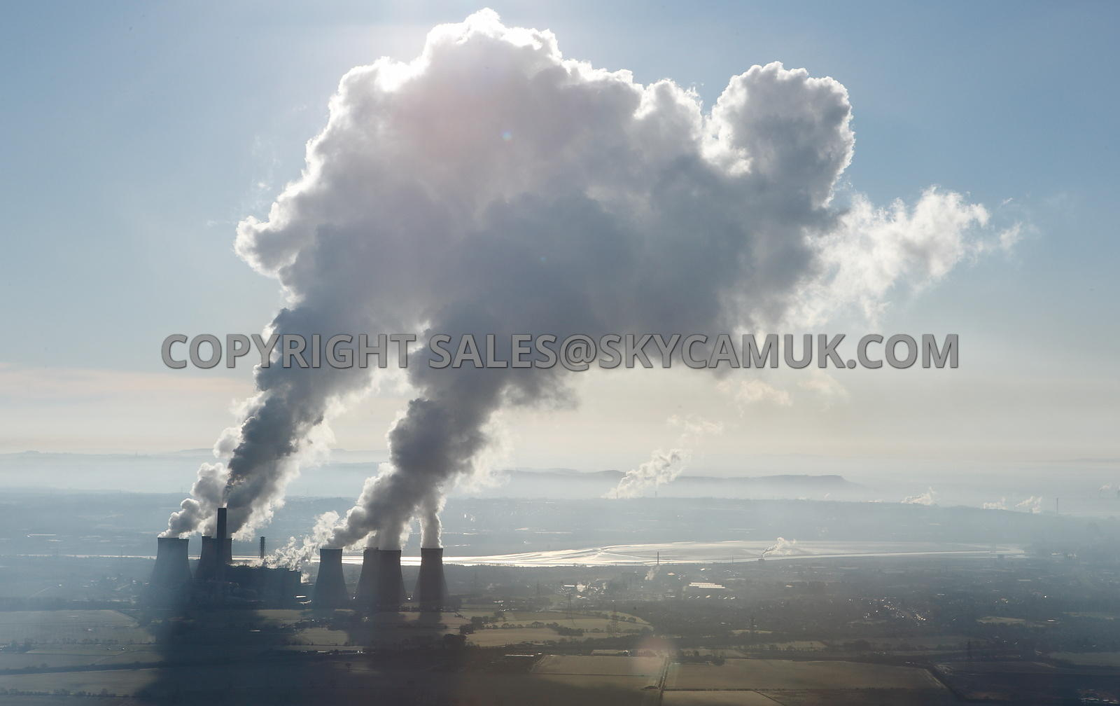 Fiddlers Ferry Power Station a dramatic aerial photograph of the clouds of steam being backlighted by the angle of the sun ou...