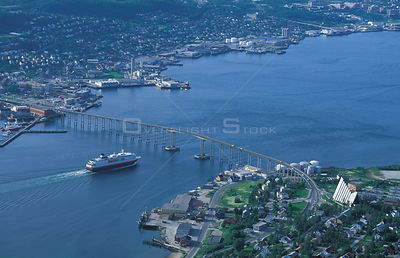 Aerial view of Tromso, Norway, with ferry approaching bridge.