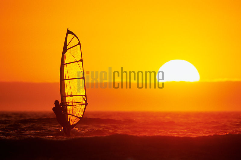 Windsurfer sailing into the sunset