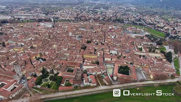 Aerial shot, beautiful panorama of Lucca city, an ancient town in the middle of Tuscany, Italy, filmed with drone.