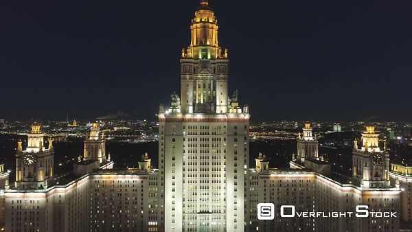 Moscow State University Main Campus and Illuminated Moscow Cityscape at Clear Winter Night. Russia. Aerial View. Drone is Fly...
