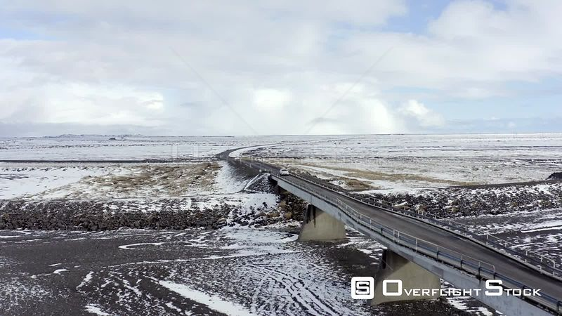 Car Crossing a Bridge on Icelandic Roads During the Winter