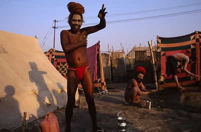India - Allahbad - saddhus at their camp wash and ready themselves for their ritual bath. Ardh Kumbh Mela 1995, Allahbad, India
