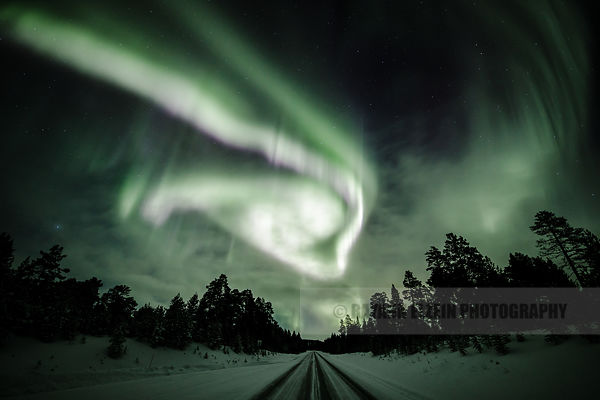 Strong aurora above the road near Inari