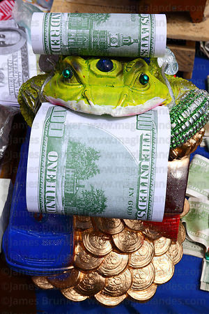 Chinese Jin Chan money toad and miniature $100 bills for sale on stall, Alasitas festival, La Paz, Bolivia