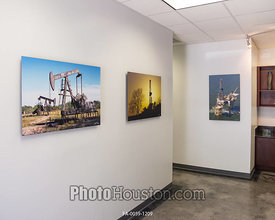 Photos displayed as office art with float framing