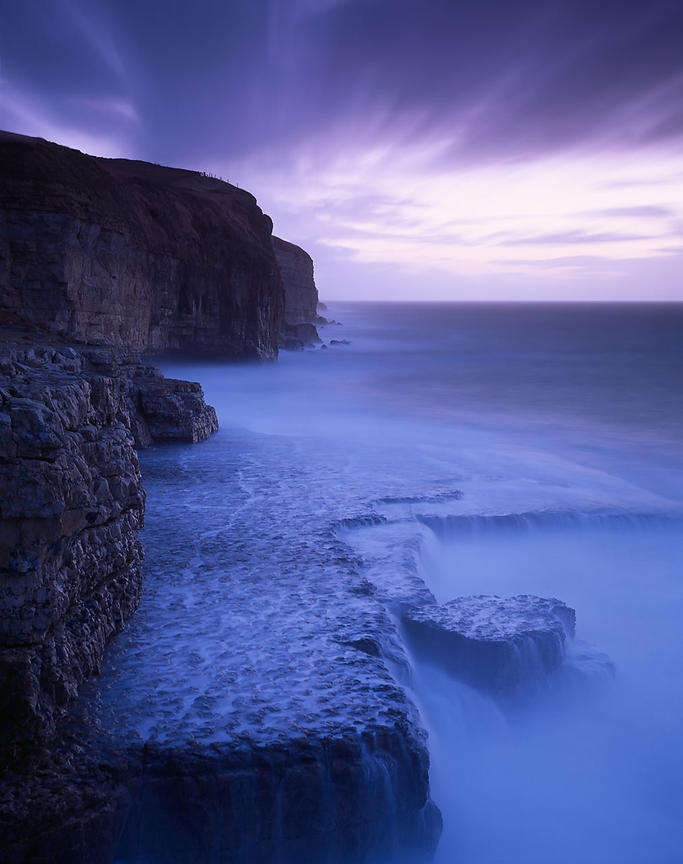 Blue light appears to pour through the water in this picture, giving the Jurassic cliffs at Dancing Ledge in Dorset, a ghostl...