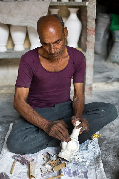 India - Jaipur - A potter finished a clay pot at a factory in Sanganer