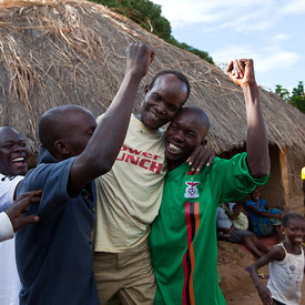 Chansa Lloyd is welcomed by his friends from the village as he returns from successful double cataract surgery