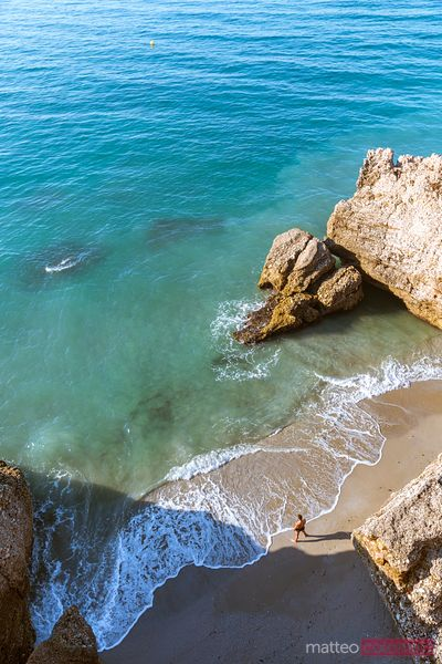 High angle view of beach with one man, Nerja, Spain