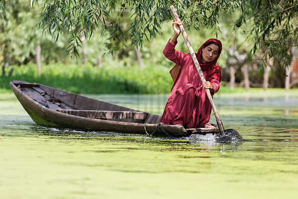 Woman on Shikara on Nigeen Lake