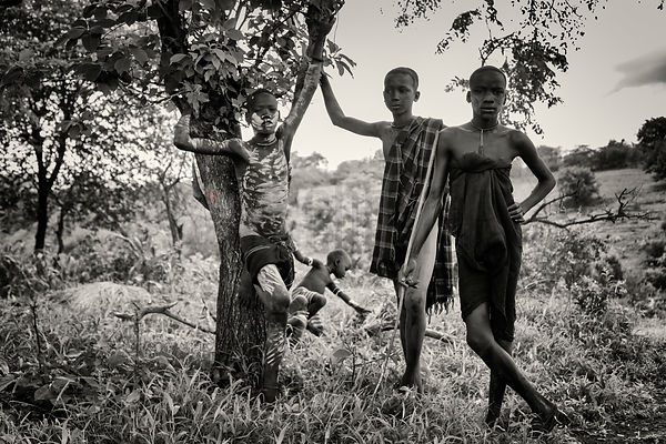 Mursi Boys Standing around a Tree