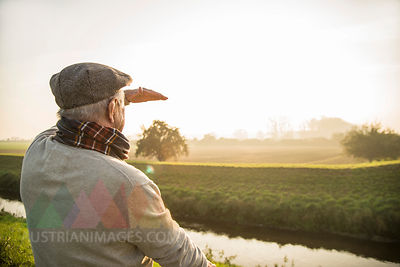Senior man in rural landscape looking at view