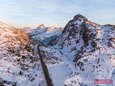 Aerial sunset over Dolomites mountain pass, Italy