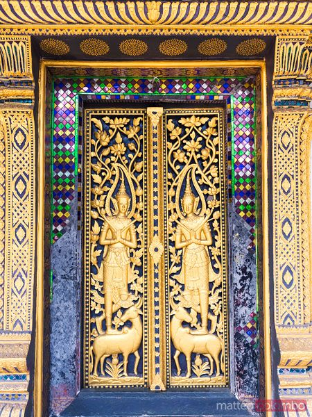 Ornate door of Wat Mai Suwannaphumaham temple, Laos