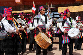 Musicians playing wooden flutes or pinkillus and drums at San Santiago festival , Taquile Island , Peru