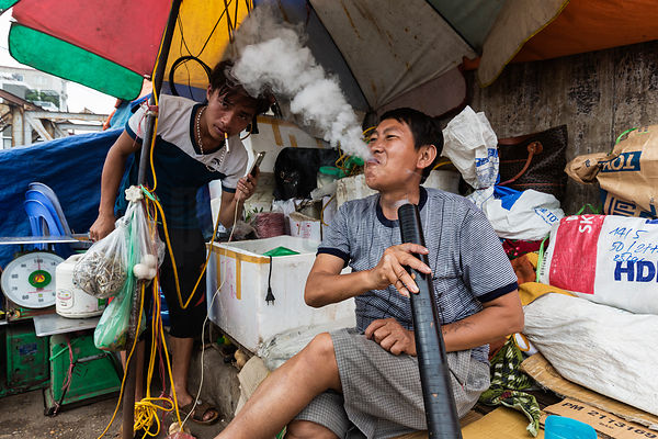 Men Smoking at Wholesale Market