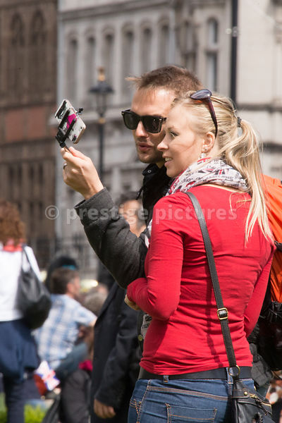 Couple using a Selphie stick to take a Close Picture of Themselves