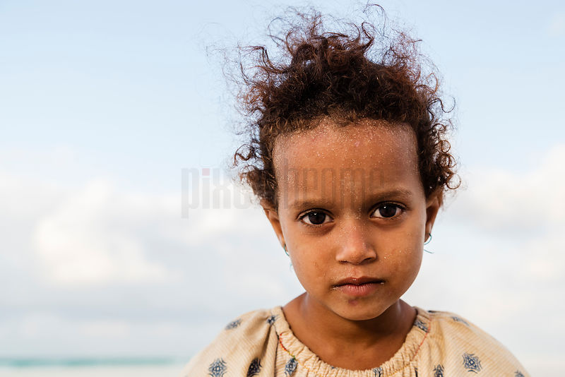 Portrait of a Young Girl on Qalansyia Beach.