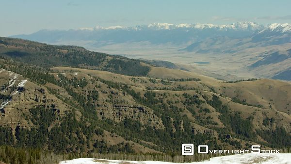 Snow-covered peaks of the Absaroka mountain range tower over the Paradise Valley and Tom Miner basin near Yellowstone Nationa...