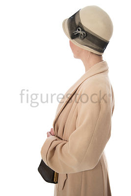 A  vintage 1920s - 1930s woman in a hat and coat – shot from eye level.