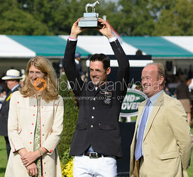 Jonathan Paget is presented with his trophy by Miranda Rock (President, LRBHT) and Jeremy Hicks (Land Rover UK), Burghley Hor...