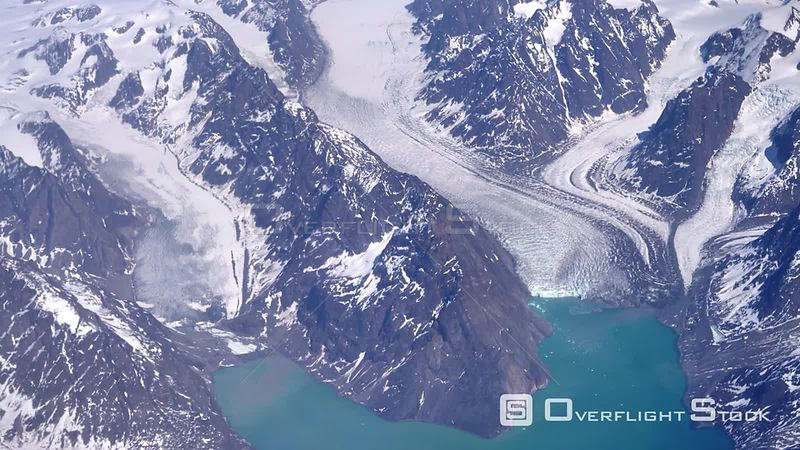 Aerial flyover glaciers emptying into ocean, sunny summer day Greenland