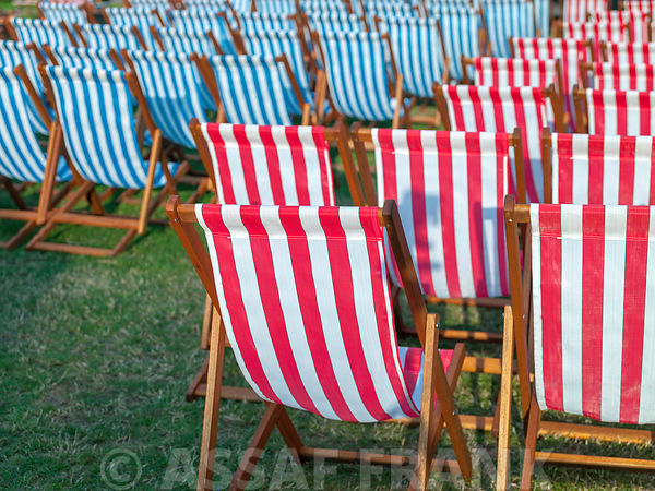 Beach chairs arranged together for an event