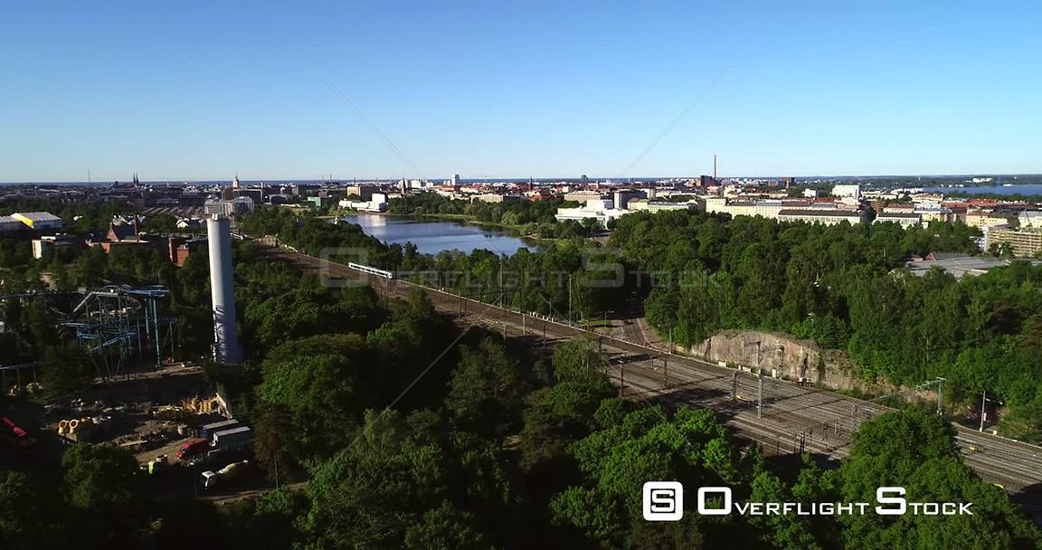 Train in a City, Aerial View Following a Train Leaving the Railway Station, in Helsinki, on a Sunny Summer Morning Dawn, in H...