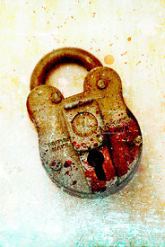 An atmospheric image of a old blood splattered padlock.
