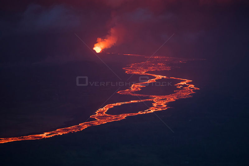 Aerial view at dusk of lava from Kilauea Volcano, erupting as fountains from fissure 8, near Pahoa, sending a river of lava t...
