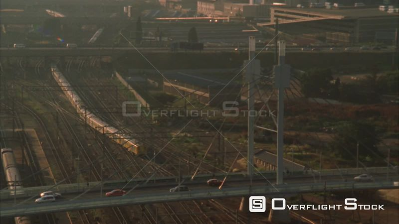 Aerial shot passing the Nelson Mandela Bridge, a railway and the Johannesburg Central Business District. Johannesburg Gauteng...