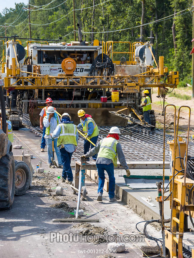 Highway construction workers prepare a rebar grid for concrete pouring