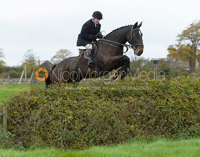 Mike Chatterton jumping a hedge near the meet in Long Clawson