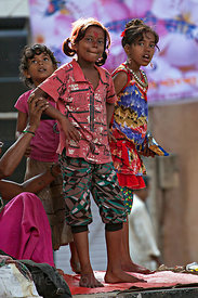 Girls watch a parade during the Ganesh Chaturthi festival in Lalbaug, Mumbai, India.