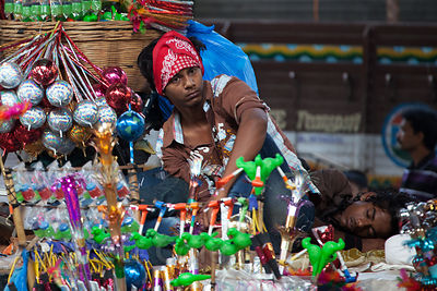 A man sells noise-makers during the Ganesh Chaturthi festival, Lalbaug, Mumbai, India.