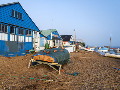Sunshine with mist over the River Exe enhances this scene of boats and the sailmaker's loft, Exmouth, Devon, UK