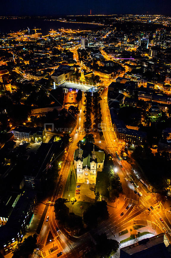 Aerial view of Tallinn, the Capital of Estonia at night, with Charles' Church in the foreground, Estonia, October 2013.