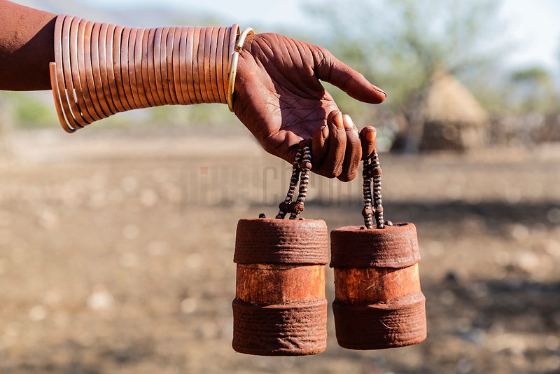 Himba Woman Holding Perfume Containers