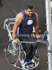 Man using a wheelchair at a gym training session