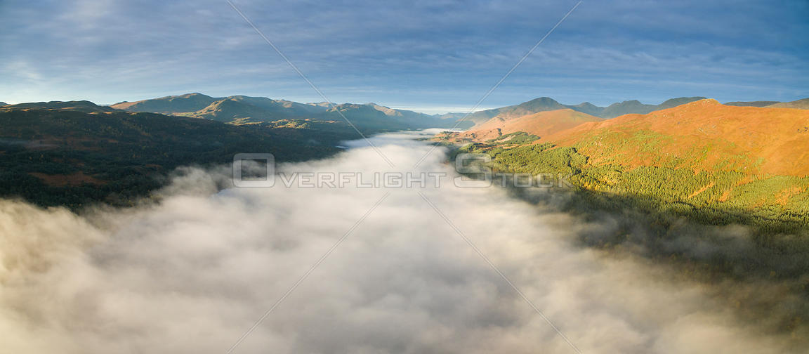 Temperature inversion with early morning mist over Loch Beinn a Mheadhoin, Glen Affric National Nature Reserve, Scotland, UK,...