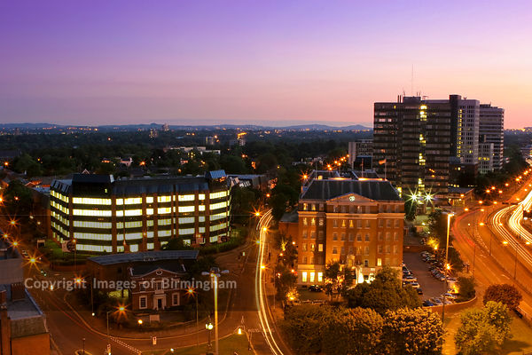 Apex House office building on Calthorpe Road and the Marriott Hotel at night.