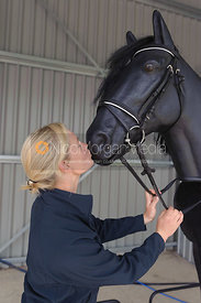 Lauren Shannon kisses the equishoot horse at the British Racing School