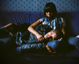 Couple on settee, Handsworth, Birmingham.