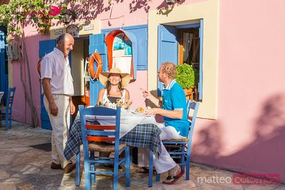 Tourists eating out in a greek village, Greece