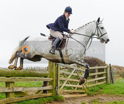 Maz Medcalf jumping at Stone Lodge Farm - The Cottesmore Hunt at Tilton on the Hill, 9-11-13