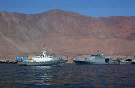 Chilean Navy Protector Class General Service Launch # LSG-1624  (L) and Maritime Zone Patrol Boat moored off desert coast nea...