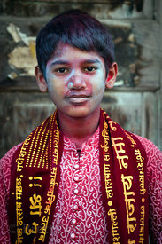 Boys covered in colored gulal powder during the Ganesh Chaturthi festival, Lalbaug, Mumbai, India