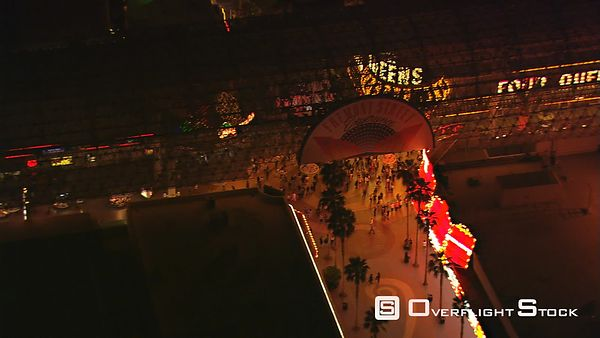 Close flight over the Four Queens on Fremont Street in Las Vegas at night.